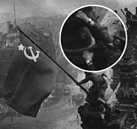 Red army soldiers raising the soviet flag on the roof of the reichstag with two Watchs.jpg