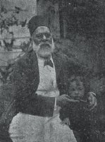 Orabi with his grandson.JPG