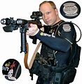 Anders Behring Breivik in diving suit with gun portrait 2.JPG