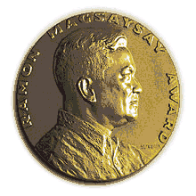 Medallion with an embossed image of Ramon Magsaysayl facing right in profile.