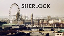 "A view of the London skyline, with the word ""Sherlock"" in black letters"