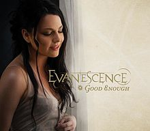 "A woman with black hair and white dress is looking forward. Below her image, the word ""Evanescence"" is written with yellow letters. In front of her, the words ""Good Enough"" are written with yellow letters."