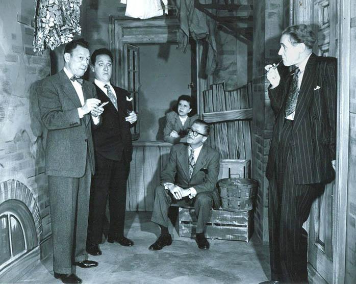 Allen's Alley cast (l to r): [[Fred Allen]], [[Kenny Delmar]], [[Minerva Pious]], Peter Donald, [[Parker Fennelly]]