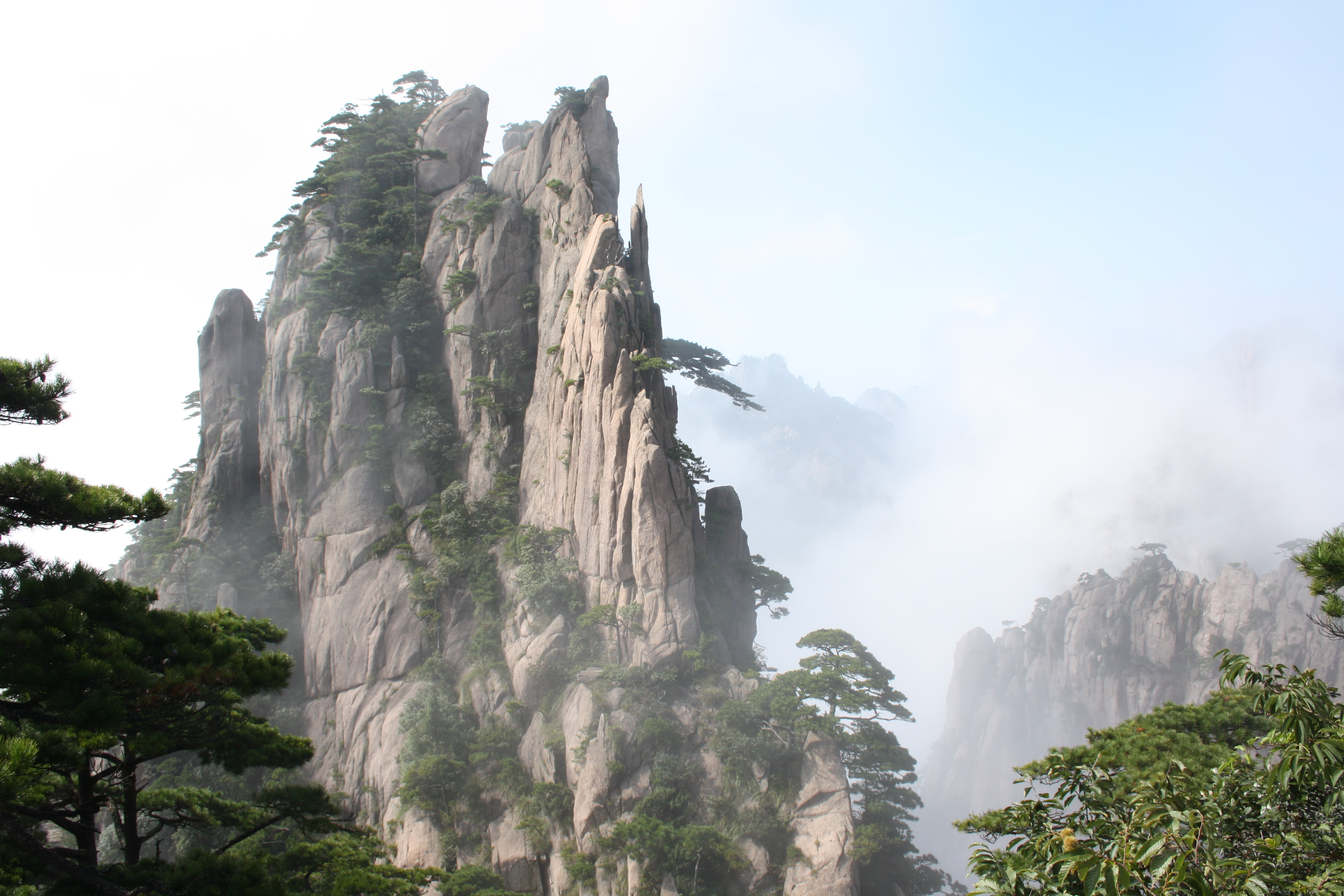 Huangshan with trees and clouds, southern Anhui province ...