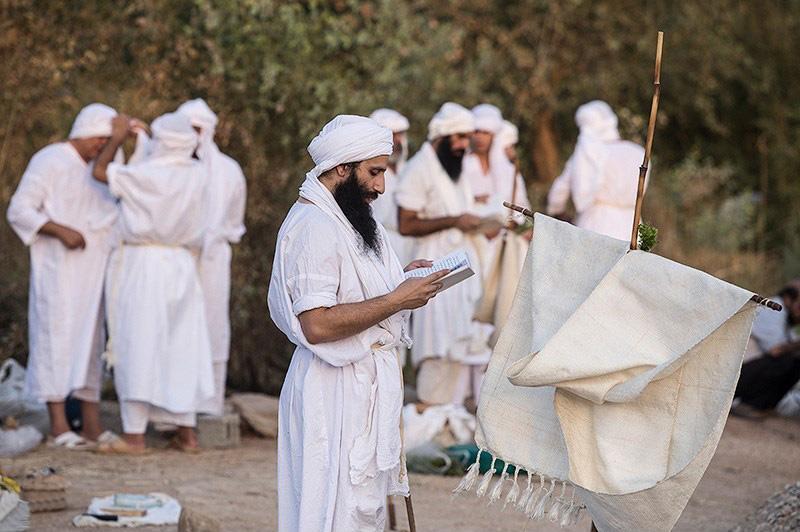 Mandaeans in prayer