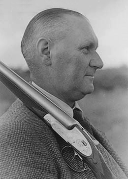 Larsen with a shotgun produced by his company in 1945