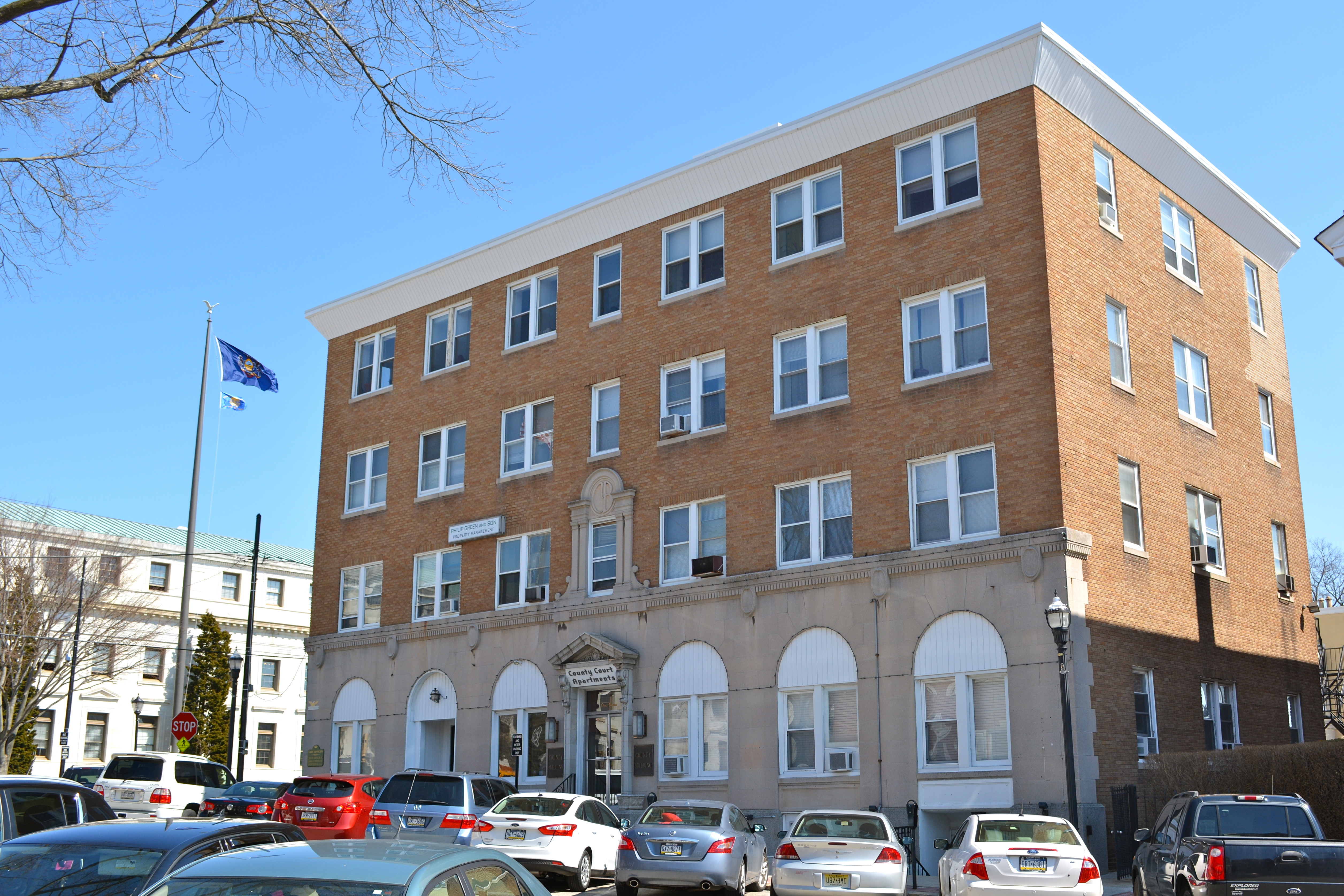 The building broken into by the Citizen's Commission to Investigate the FBI, at One Veterans Square, Media, Pennsylvania. A brown brick building with cars in front of it.