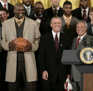 Shaquille O'Neal, Pat Riley and Micky Arison at the White House.jpg