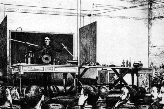 Aquí tenemos a Tesla demostrando la transferencia de energía electrica inalambricamente (año 1891)