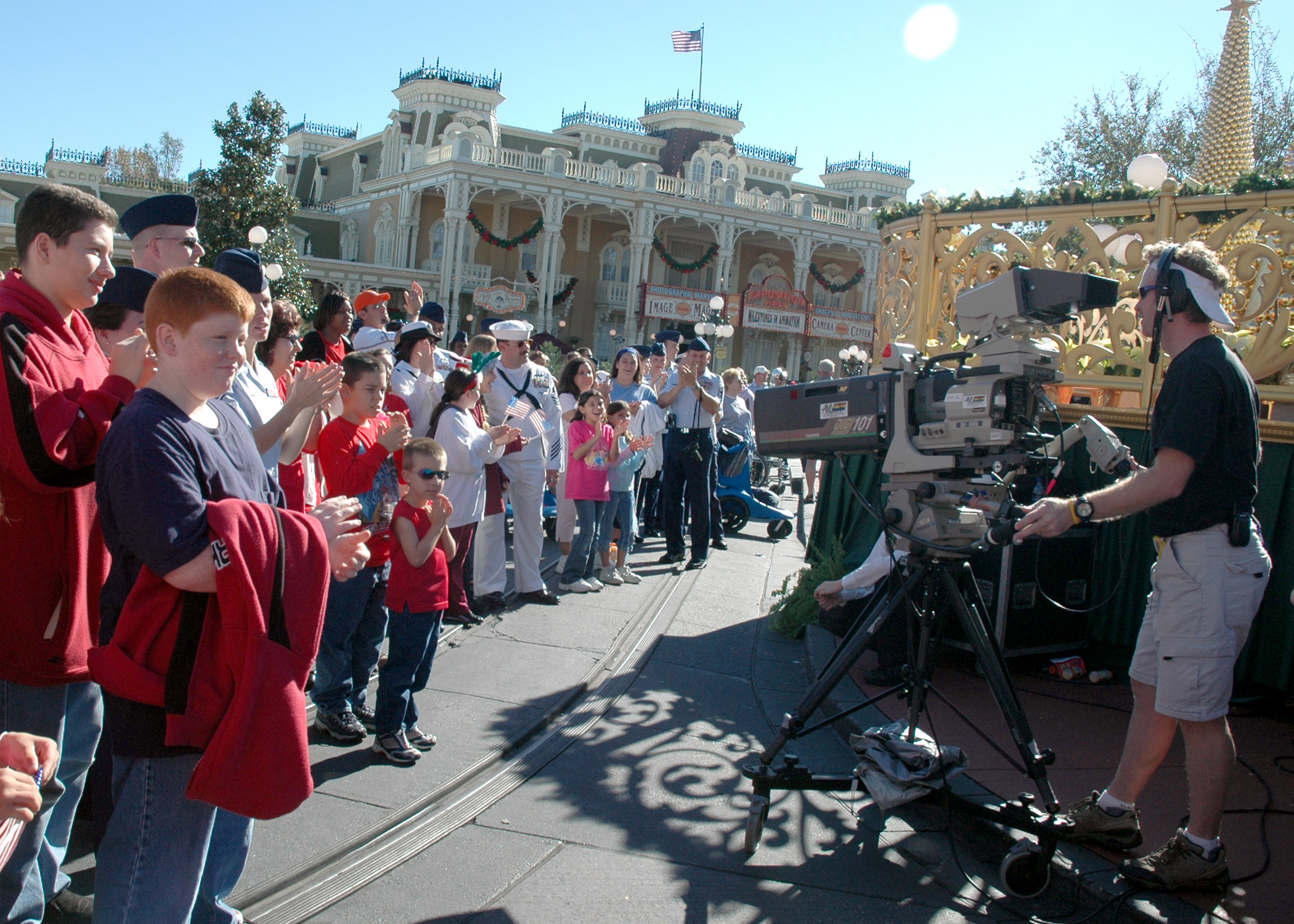 fileus navy 051204 n 8102j 004 members of the armed forces and their families participate in the taping of the 2005 walt disney world christmas day