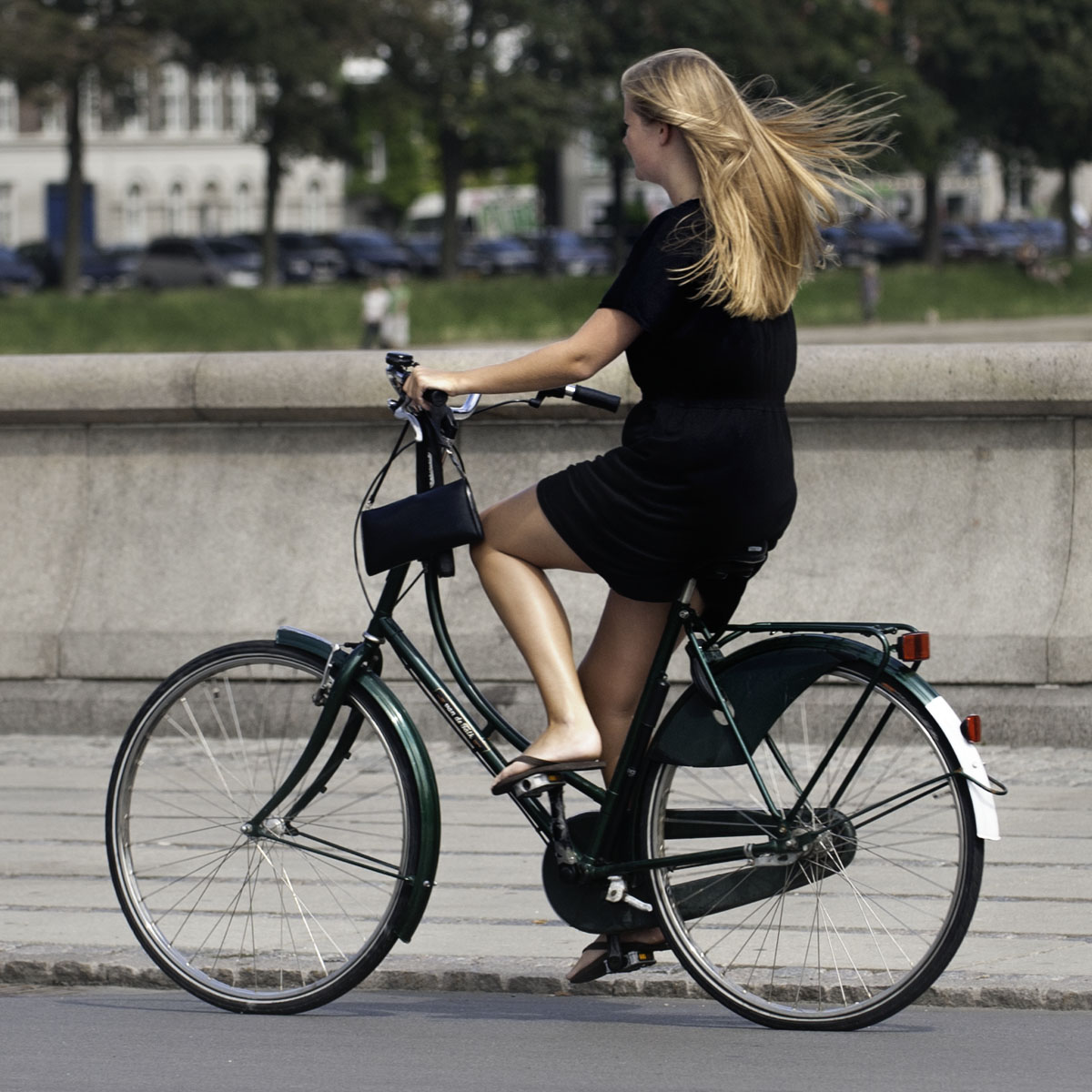 Girl commuting to work or school by bike