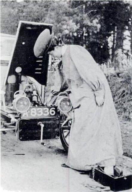 Woman repairing car engine