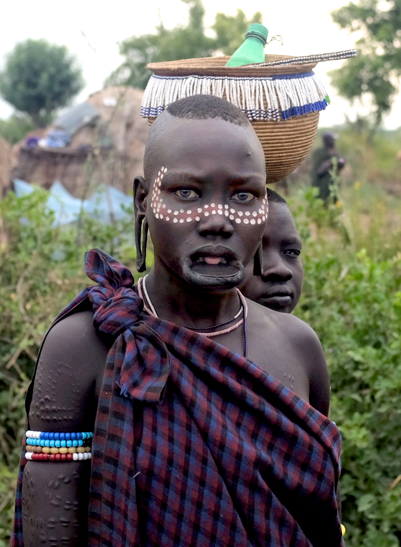 African tribes with discs attached to penis