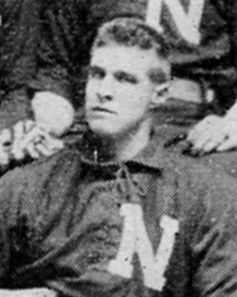 "A man in a dark baseball uniform with a white ""N"" on the chest."
