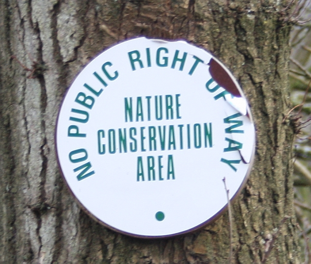 http://upload.wikimedia.org/wikipedia/commons/0/02/Nature_Conservation_Area_sign%2C_Blackmore_Wood_-_geograph.org.uk_-_1164719.jpg