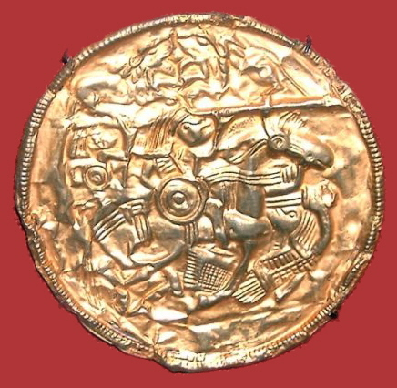 "The gold bracteate of Pliezhausen (6th or 7th century) shows typical iconography of the pagan period. The bracteate depicts the ""horse-stabber underhoof"" scene, a supine warrior stabbing a horse while it runs over him. The scene is adapted from Roman era gravestones of the region. Reiterscheibe von Pliezhausen v2.jpg"