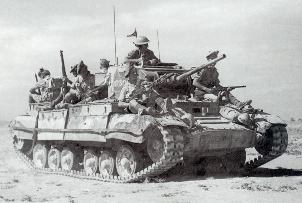 A Valentine Mk.III in the Libyan desert, carrying Scottish infantry on its way to the front.