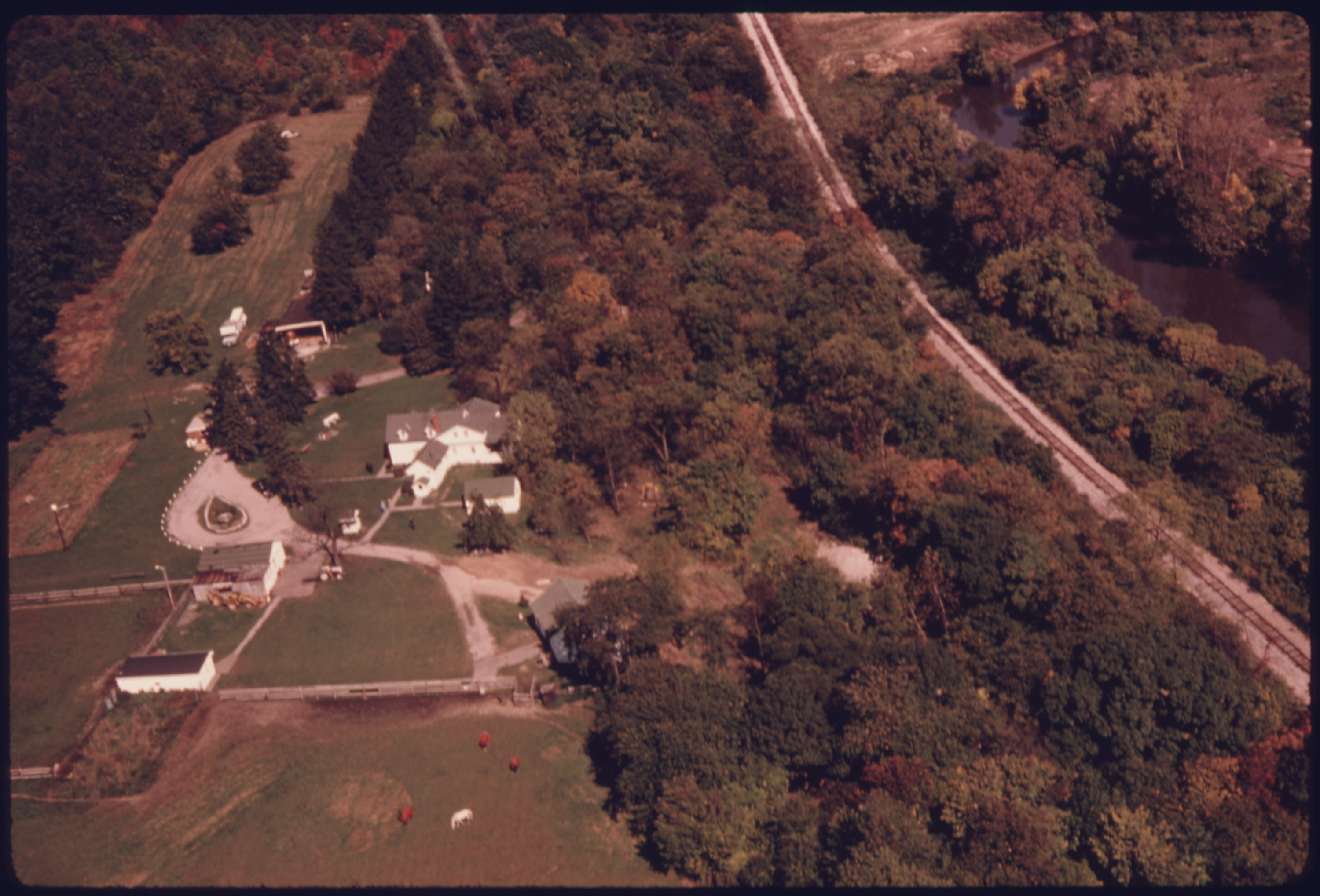 file aerial view of a farm with horses and cattle nestled along the cuyahoga river  south of