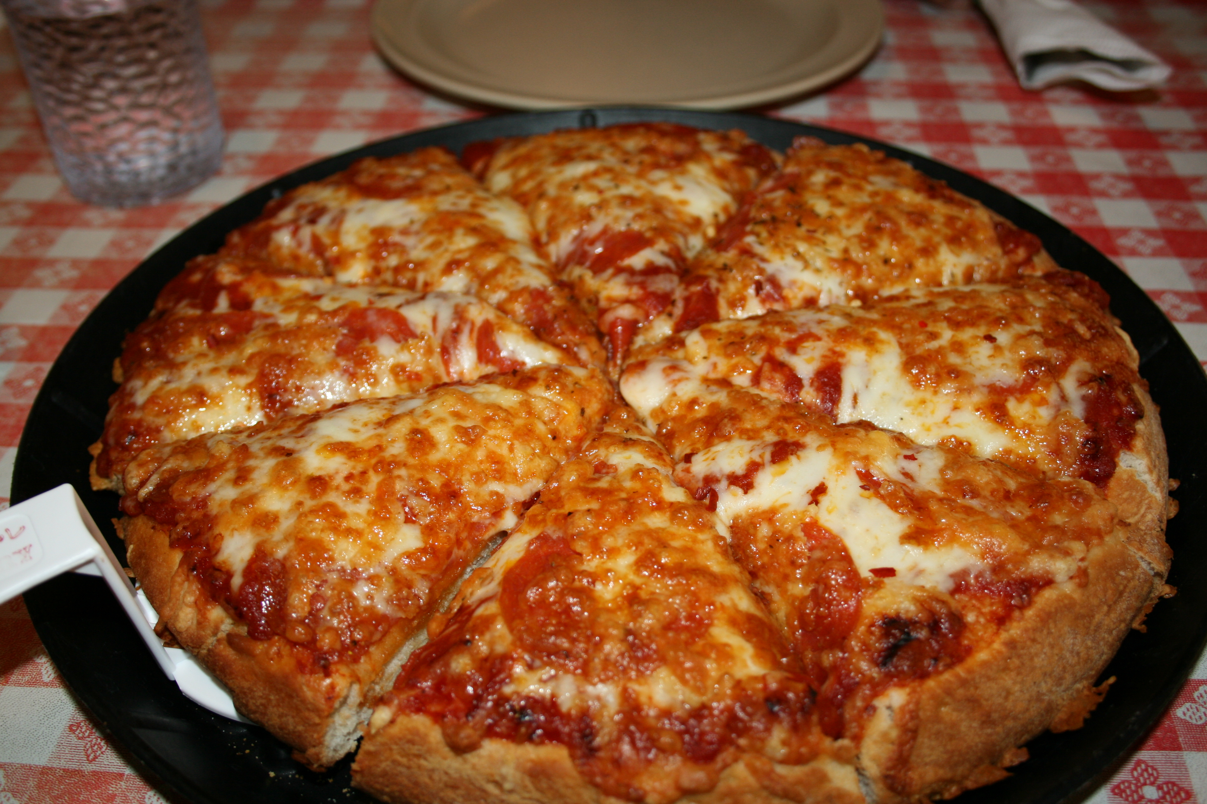 Pizza is a savory dish of Italian origin, consisting of a usually round, flattened base of leavened wheat-based dough topped with tomatoes, cheese, and various other ingredients (anchovies, olives, meat, etc.) baked at a high temperature, traditionally in a wood-fired oven. In formal settings, like a restaurant, pizza is eaten with knife and.