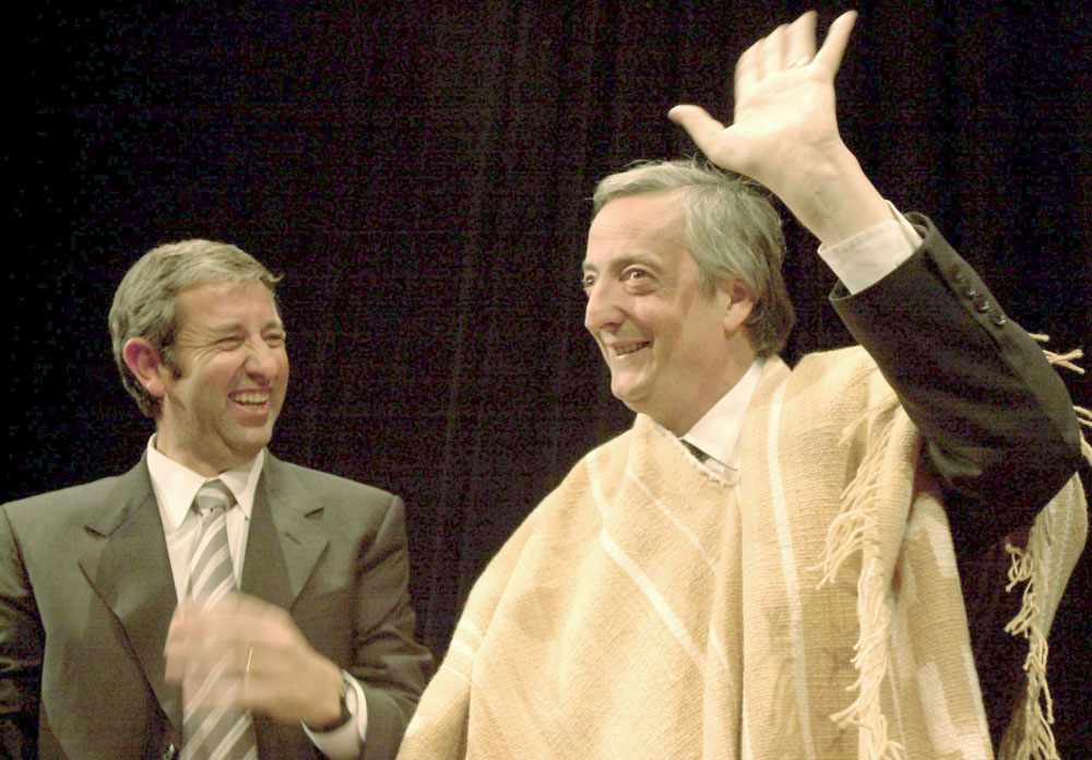 Then-Governor Julio Cobos (left) and the poncho-clad President Kirchner in Mendoza, 2004. Cobos broke with Kirchner in 2008.
