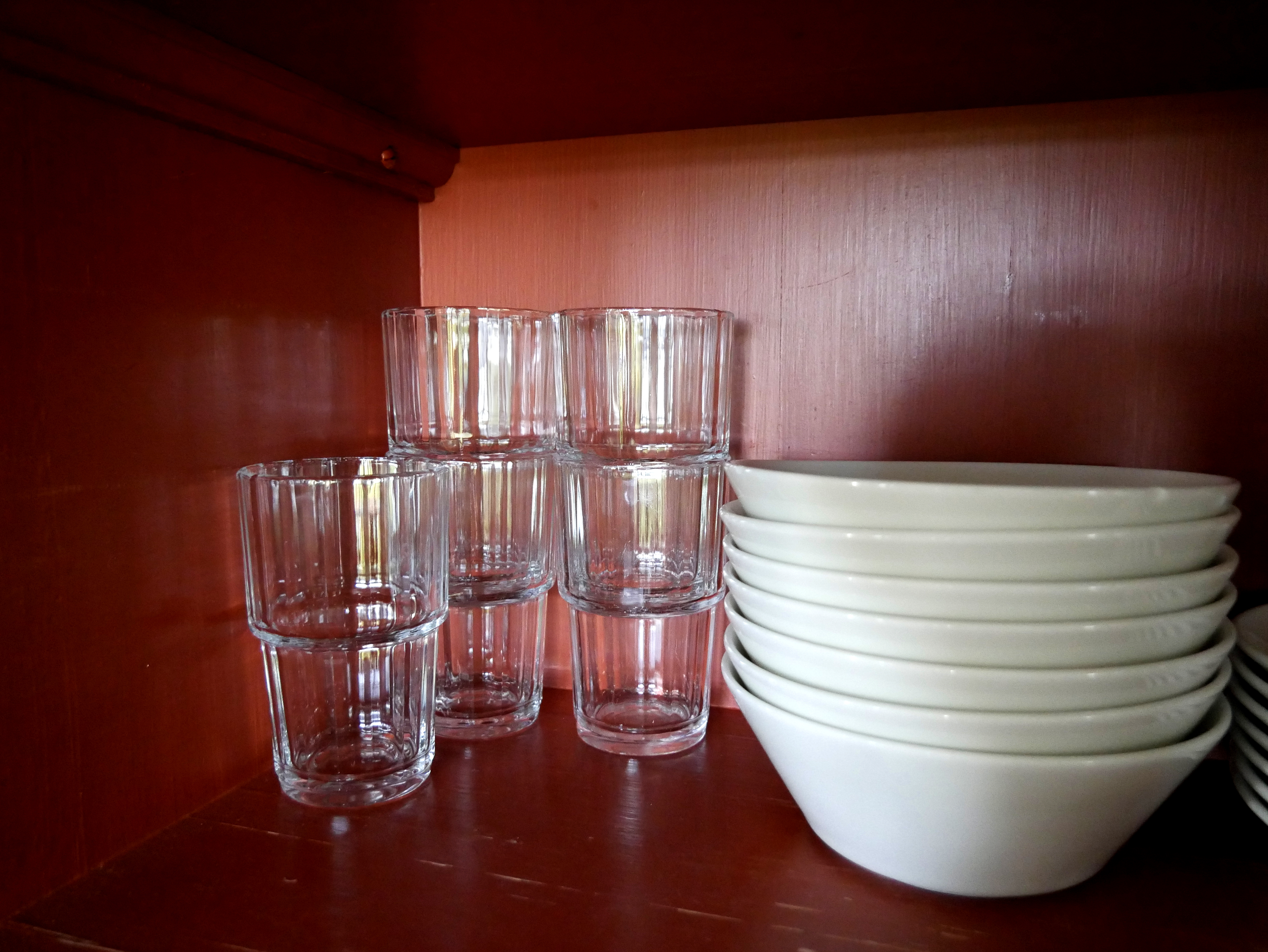 File:Drinking glasses and plates in kitchen cupboard ...