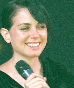 Mia Kirshner red lighted cropped.jpg