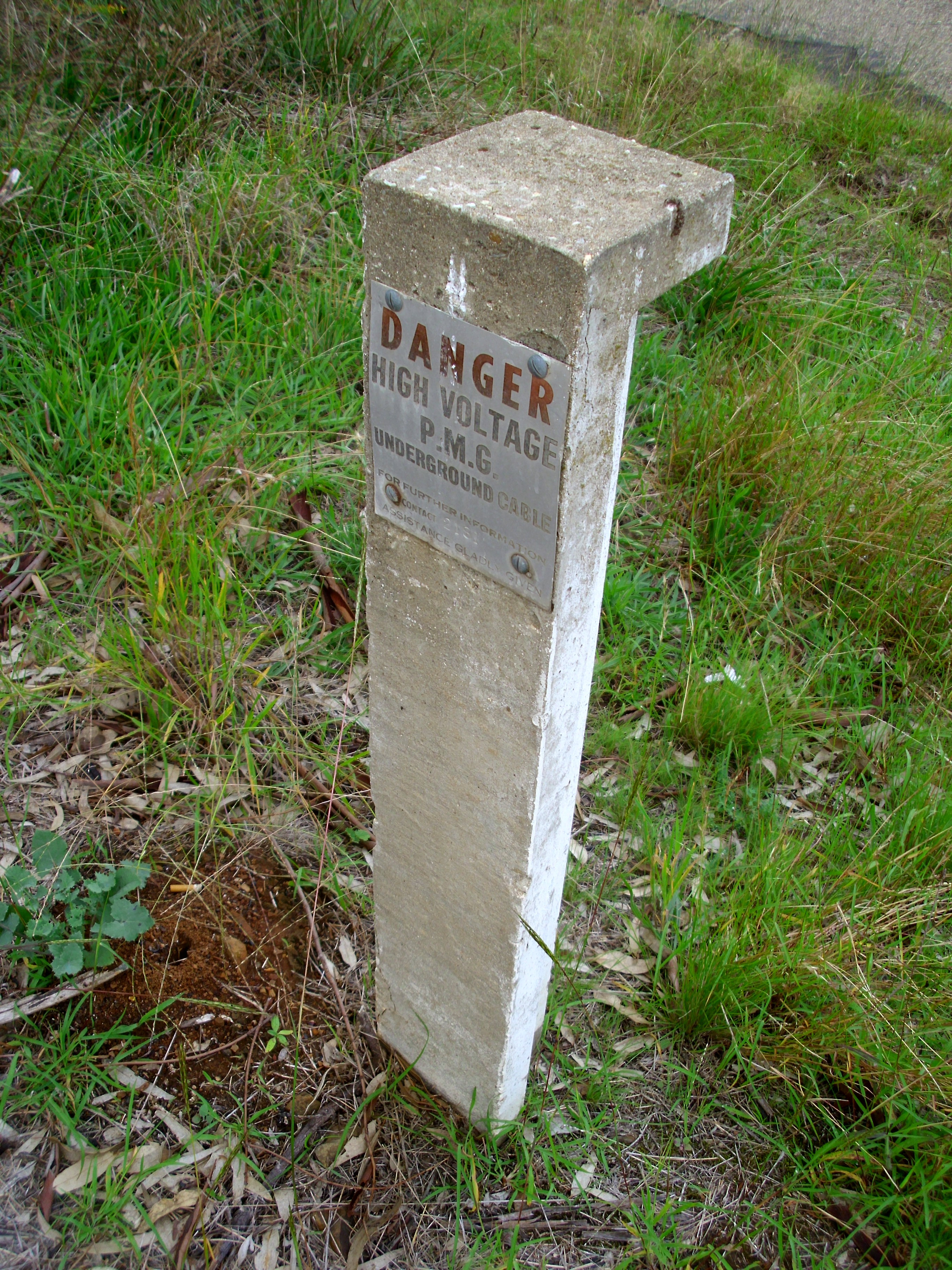 PMG danger sign on a concrete post on Willans Hill.jpg