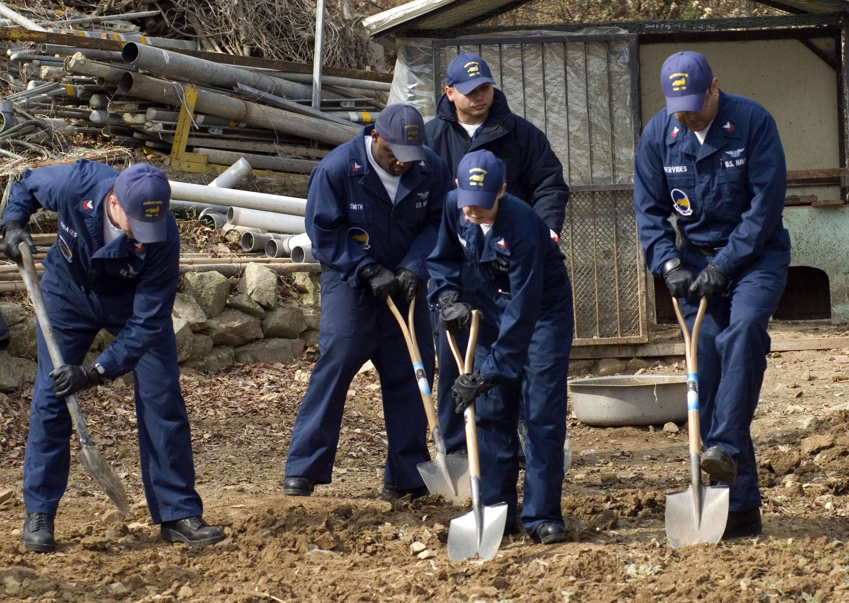 File us navy 090312 n 0673m 005 sailors dig up rocks and for Preparation of soil wikipedia