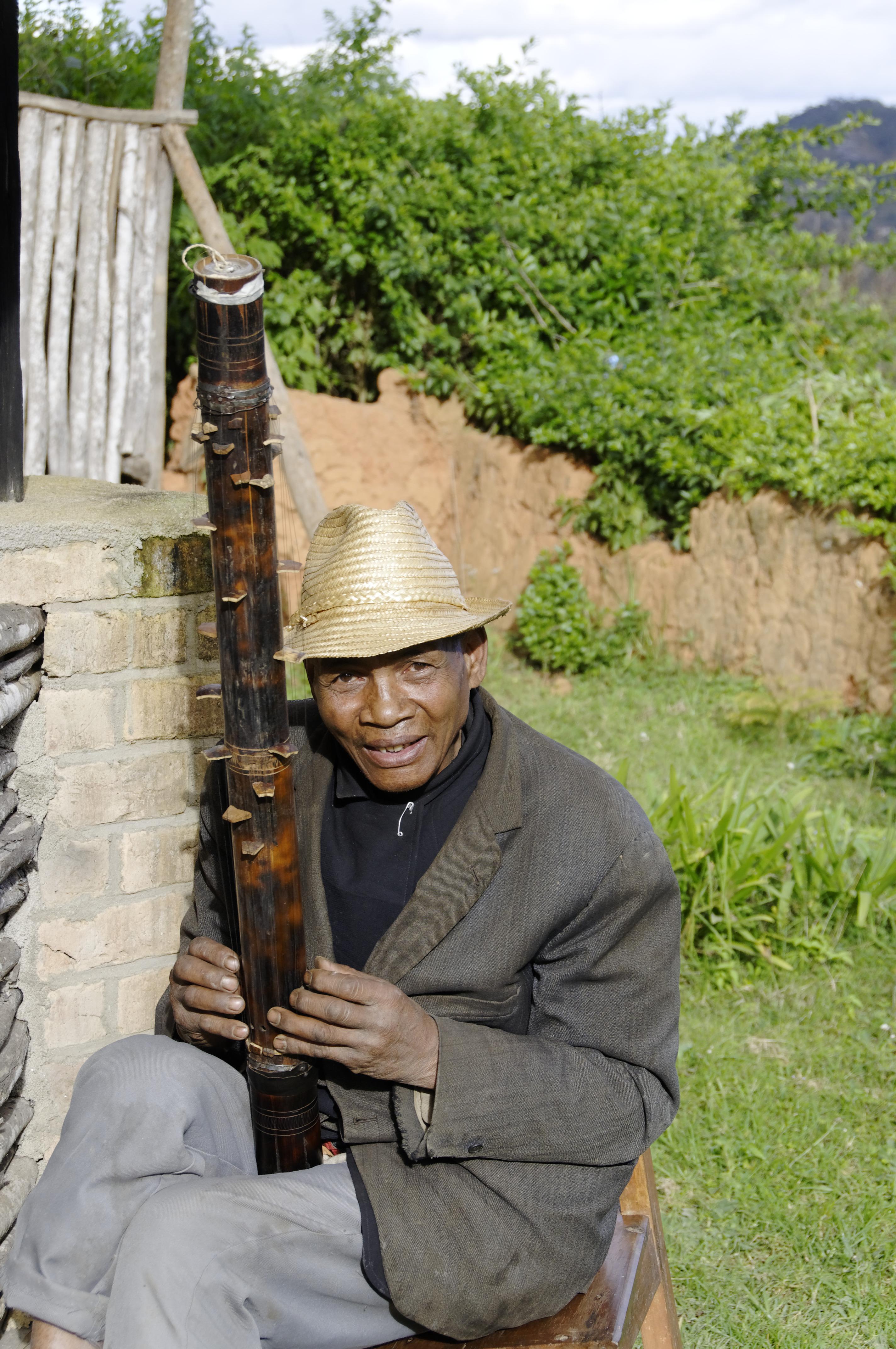 Valiha player in Ambohimahasoa