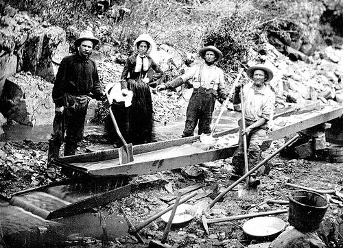 The California Gold Rush news of gold brought some 300,000 people to California from the rest of the United States and abroad. 1850 Woman and Men in California Gold Rush.jpg