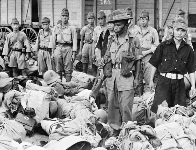 file a gurkha soldier guards japanese prisoners on their
