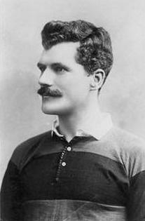 Profile photograph of Arthur Gould wearing the black and amber hooped shirt of Newport RFC.