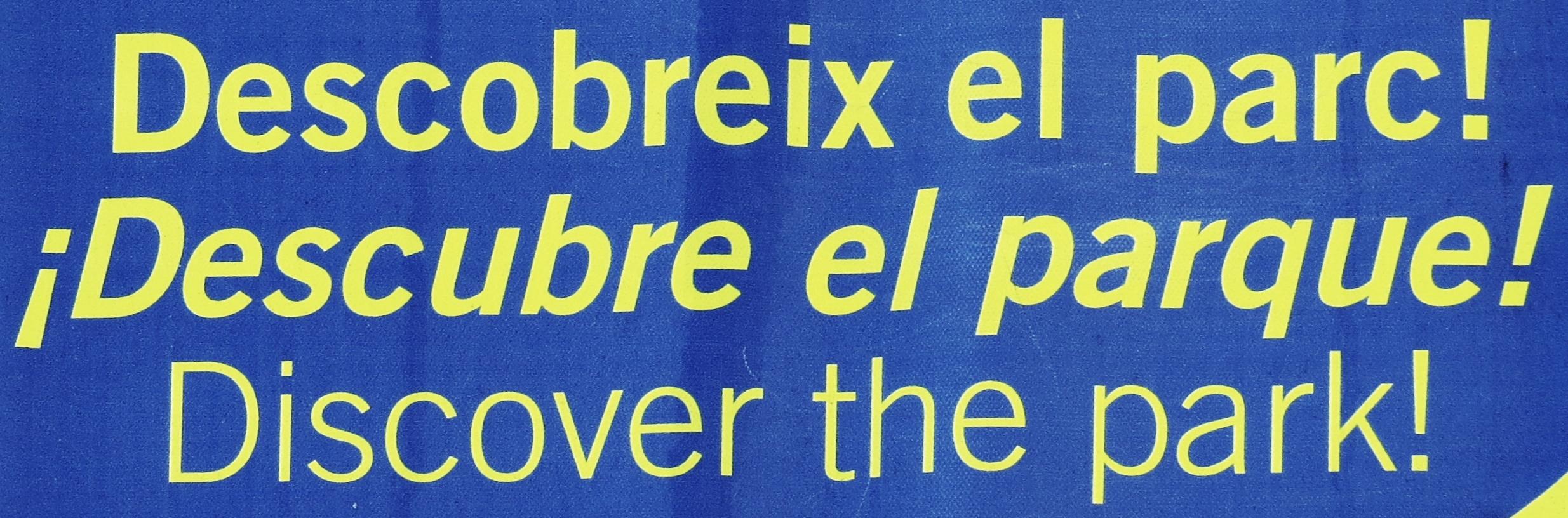 rilingualbillboardinarcelonadetail,showingtheinitialexclamationmarkforpanish,butnotforatalanatalanlanguagetoplineandnglish.
