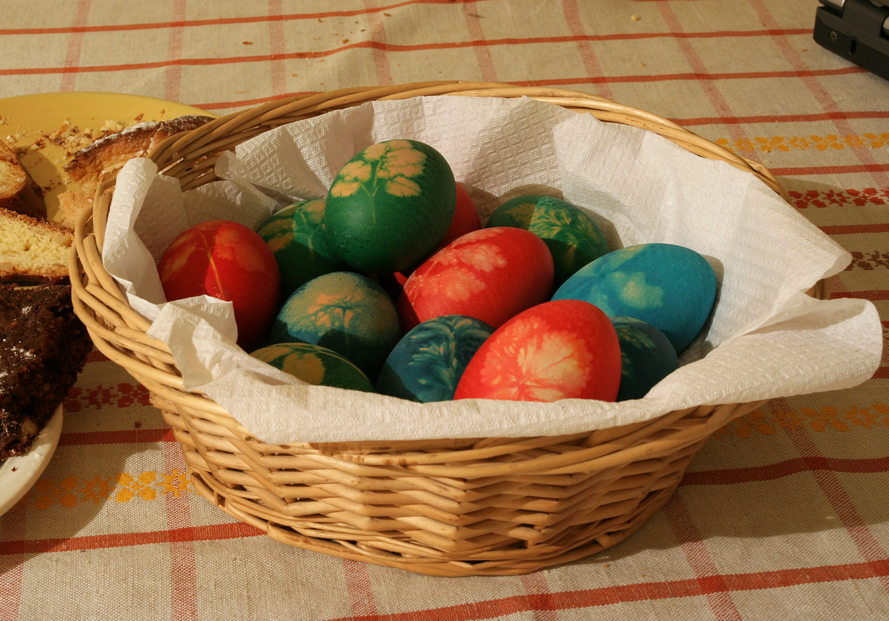Easter eggs sit in a basket