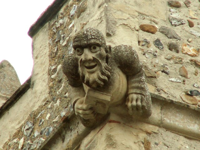 Gargoyle on the church of All Saints in Willian. Via Wikimedia Commons.