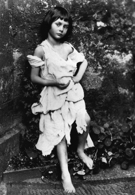 Liddell dressed up as a beggar-maid. Photo by Lewis Carroll (1858).