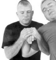 A hyperflexing wristlock used as a pain compliance technique.