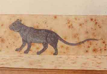 vyobrazení modré kočky (pravděpodobně korat) v thajském rukopise.