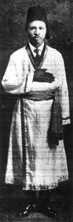 Drew in a long gown with his hand held over his chest