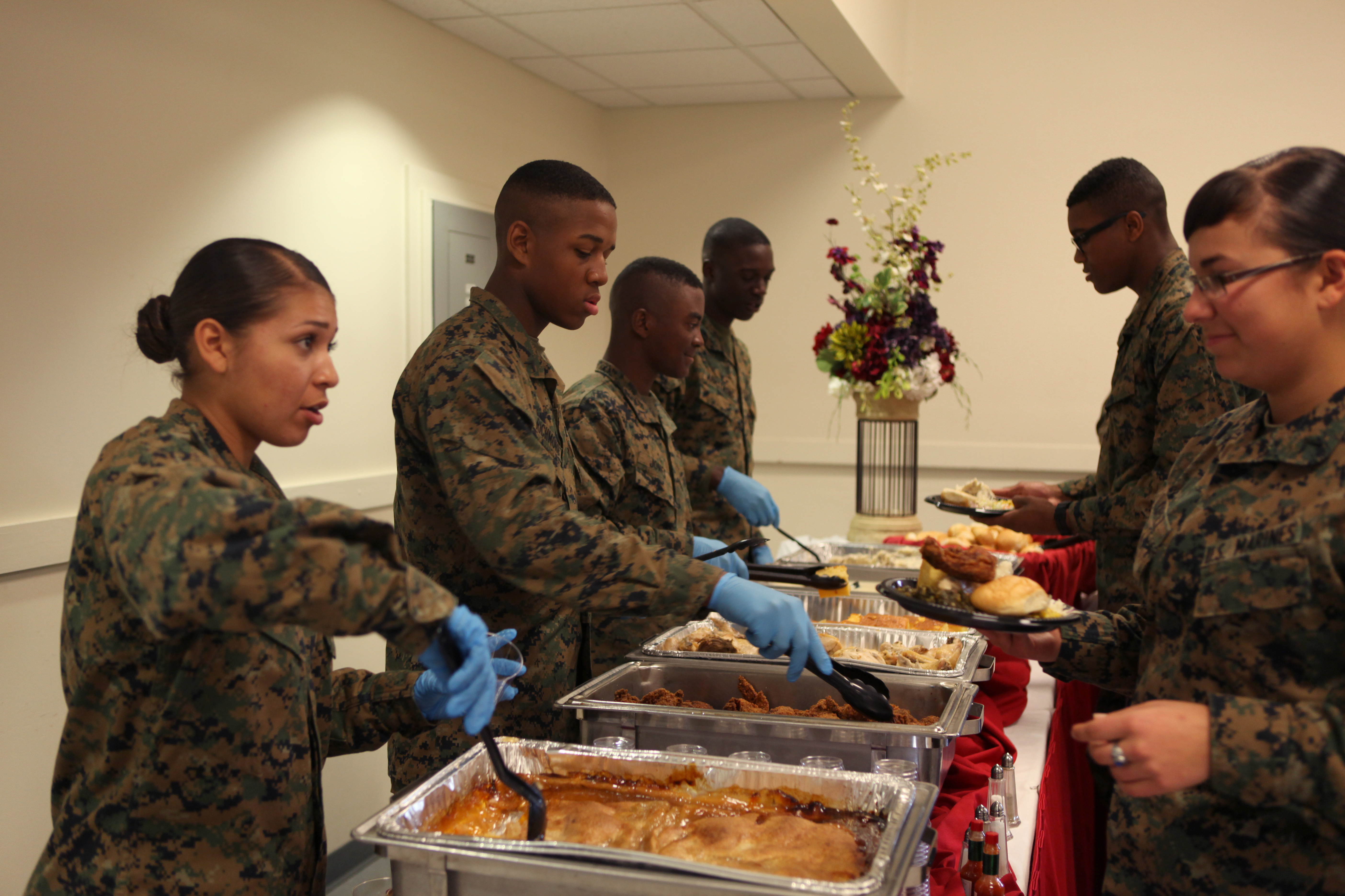 Students of U. S. Marine Corps Combat Service Support Schools serve food to attendees of the Black History Month Closing Ceremony on Camp Johnson, N.C., Feb. 27, 2013.