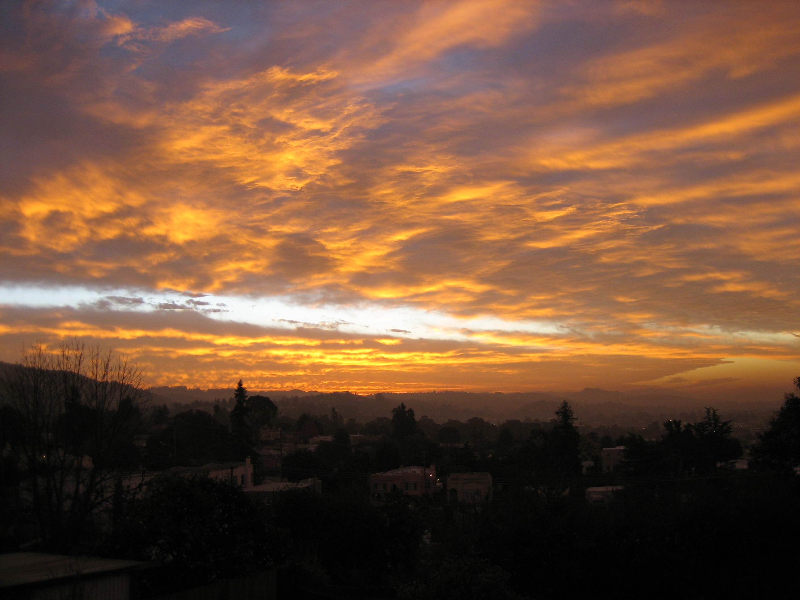 The sun rises over Oakland, Calif. Photo by: Daniel Olsen