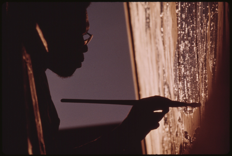file artist ron blackburn painting an outdoor wall mural at the file artist ron blackburn painting an outdoor wall mural at the corner of 33rd and