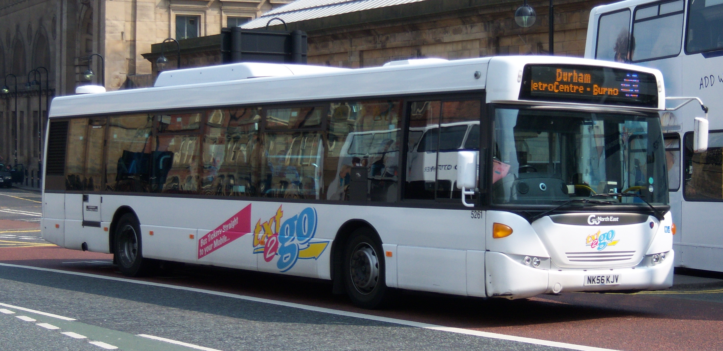 File:Go North East bus 5261 Scania CN230 Omnicity NK56 KJV Txt2Go livery in Newcastle