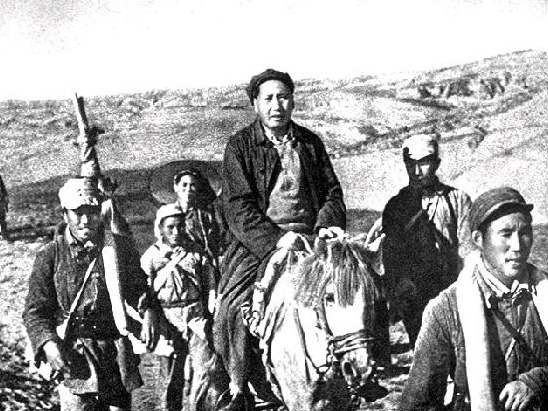 photo showing Mao Zedong riding his white horse during the Long March, 1934-1935