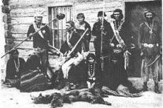 Navajo hunters outside Sam Days Trading Post year 1887.jpg
