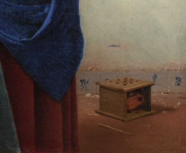 Painting detail showing the foot warmer, with tiles of Cupid and a man with a pole on either side of it; the clothes basket Vermeer removed from the painting was here. Also shown is a detail from the maid's brilliant blue apron. Vermeer, Johannes, The Milkmaid (about 1657-58).jpg