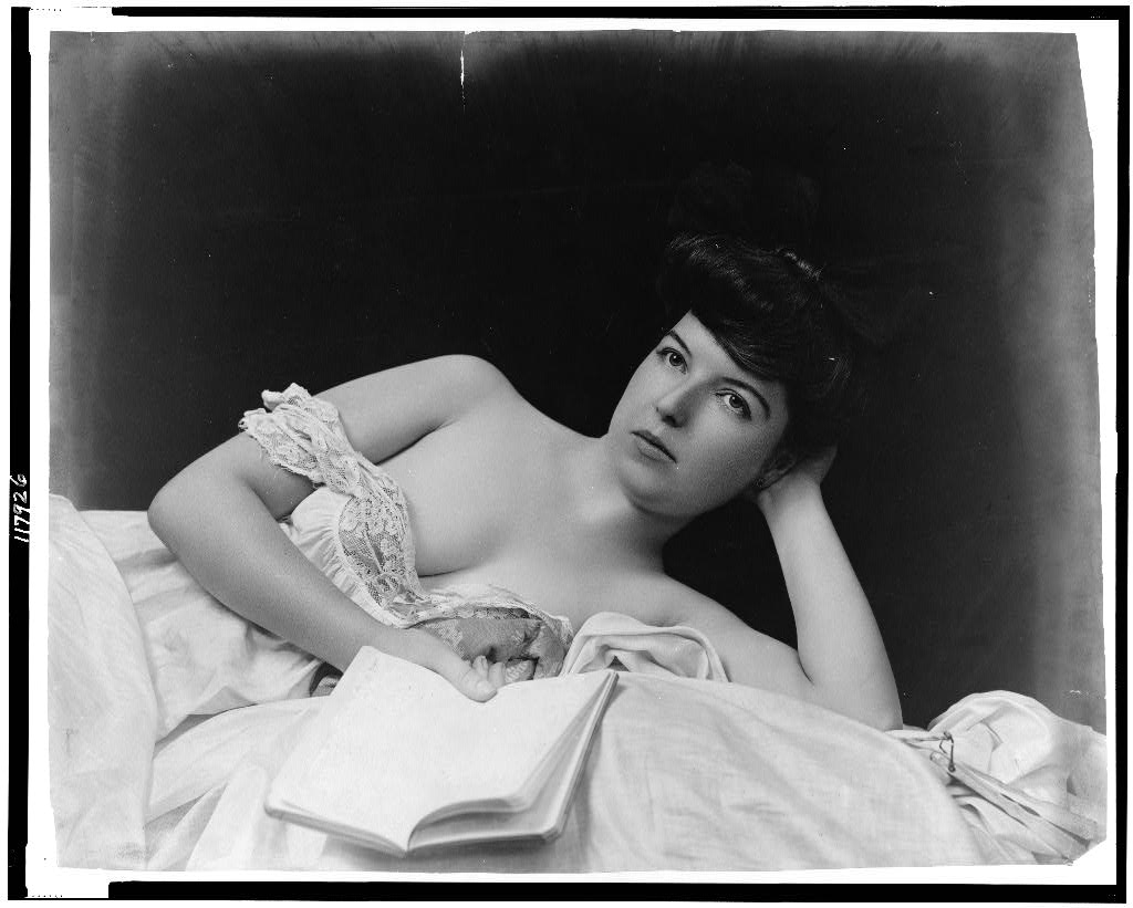 http://upload.wikimedia.org/wikipedia/commons/0/06/Young_woman,_wearing_negligee,_lying_in_bed,_holding_book.jpg