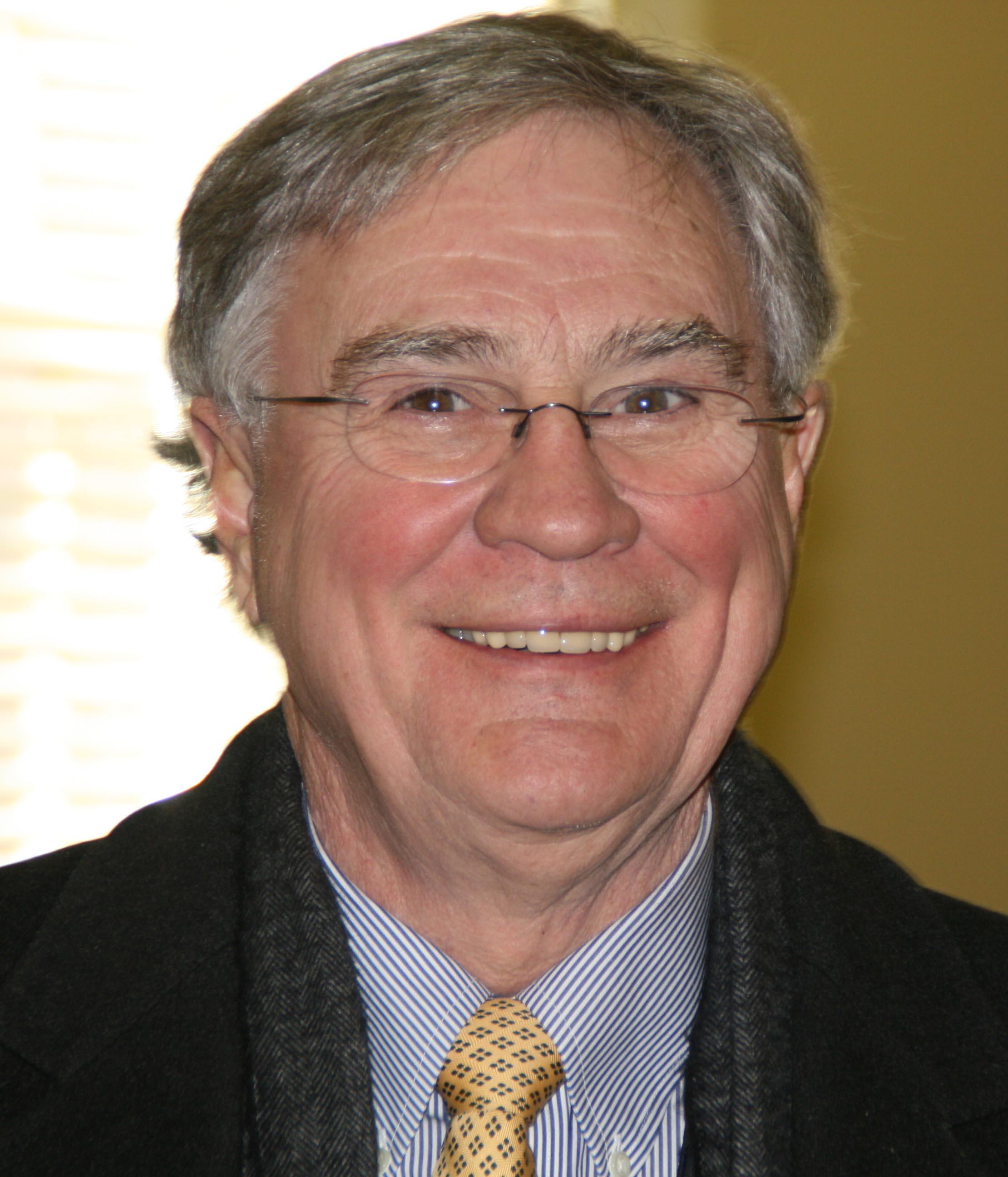 Dennis C . McCoy
