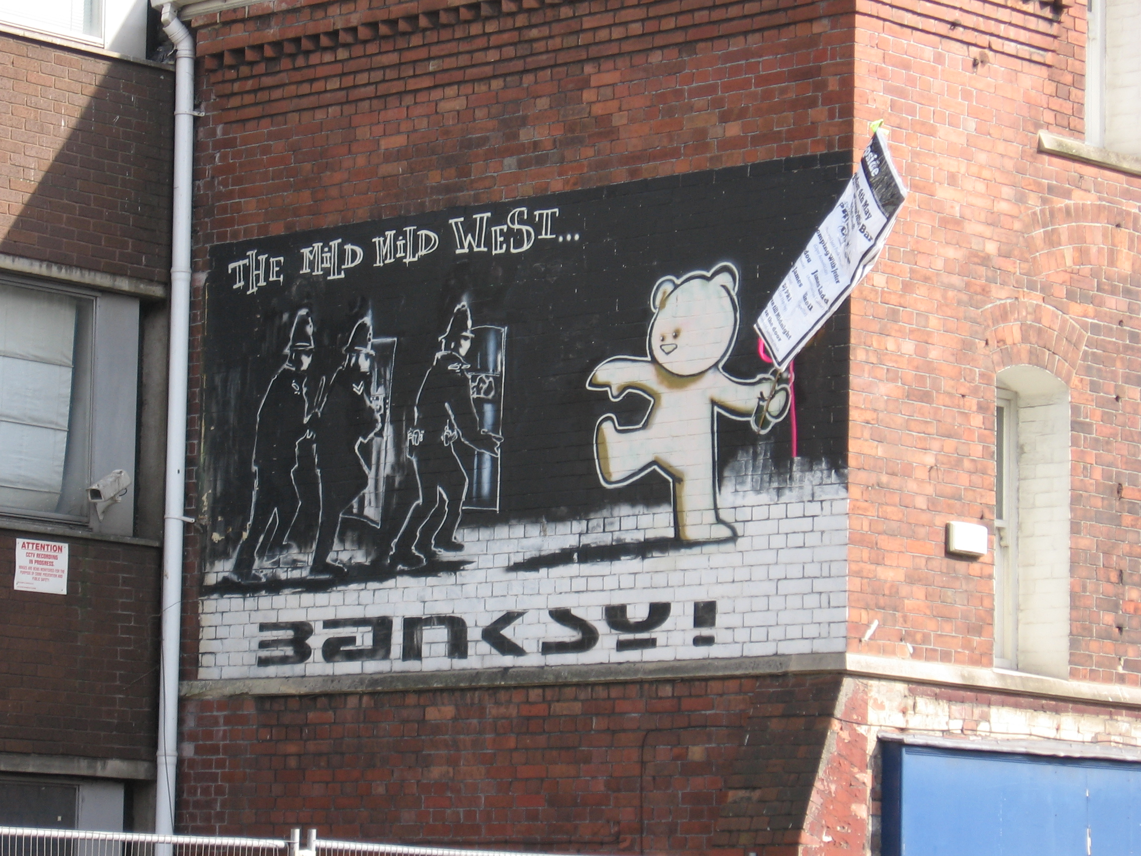 File:Banksy MIld Mild West and poster.jpg - Wikimedia Commons