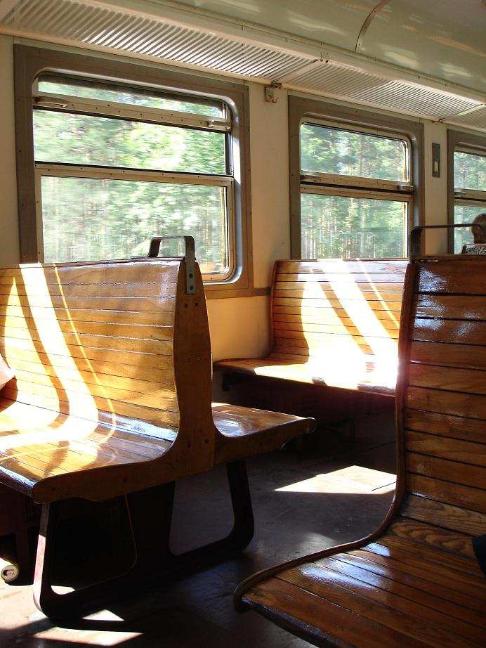 Inside of old train, with wooden seats